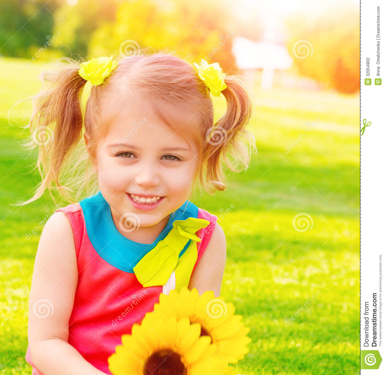 Little Girl With Sunflowers Bouquet Stock Photo