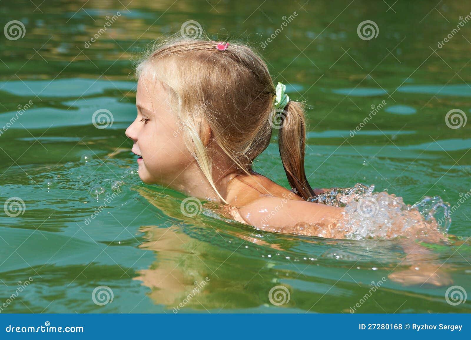 Joyful Little Girl Swimming In The Pool. Royalty Free