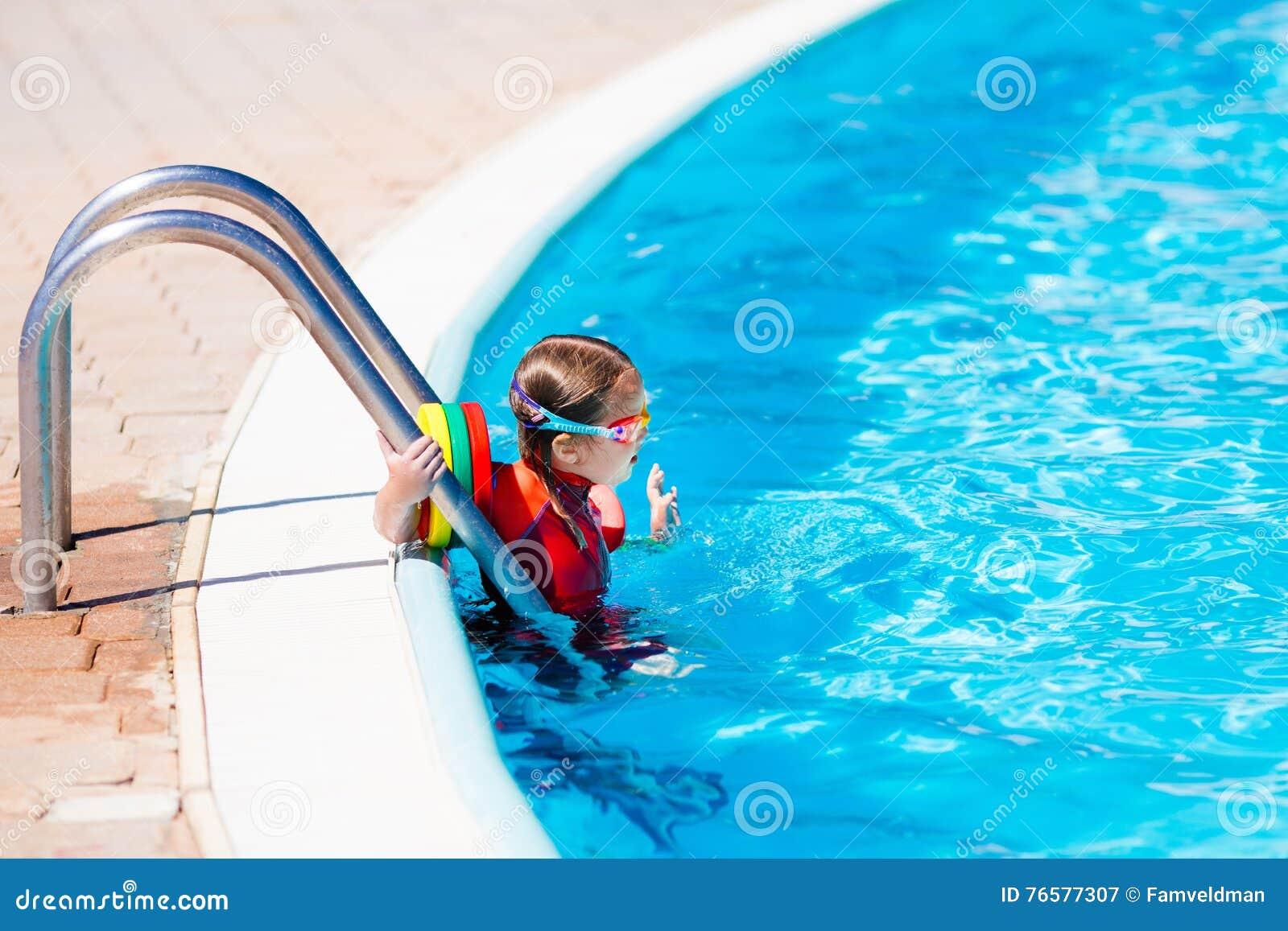 Little Girl In Swimming Pool Stock Image - Image of aqua