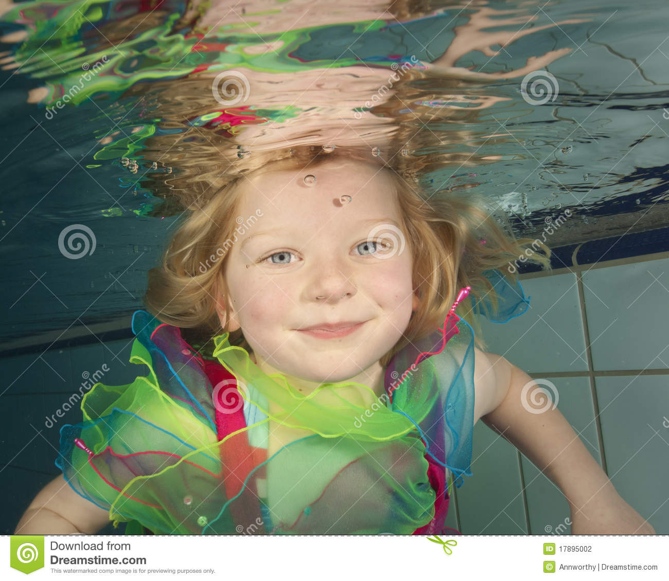 Little Girl Swimming Underwater Stock Photography - Image ...: https://www.dreamstime.com/stock-photography-little-girl-swimming-underwater-image17895002