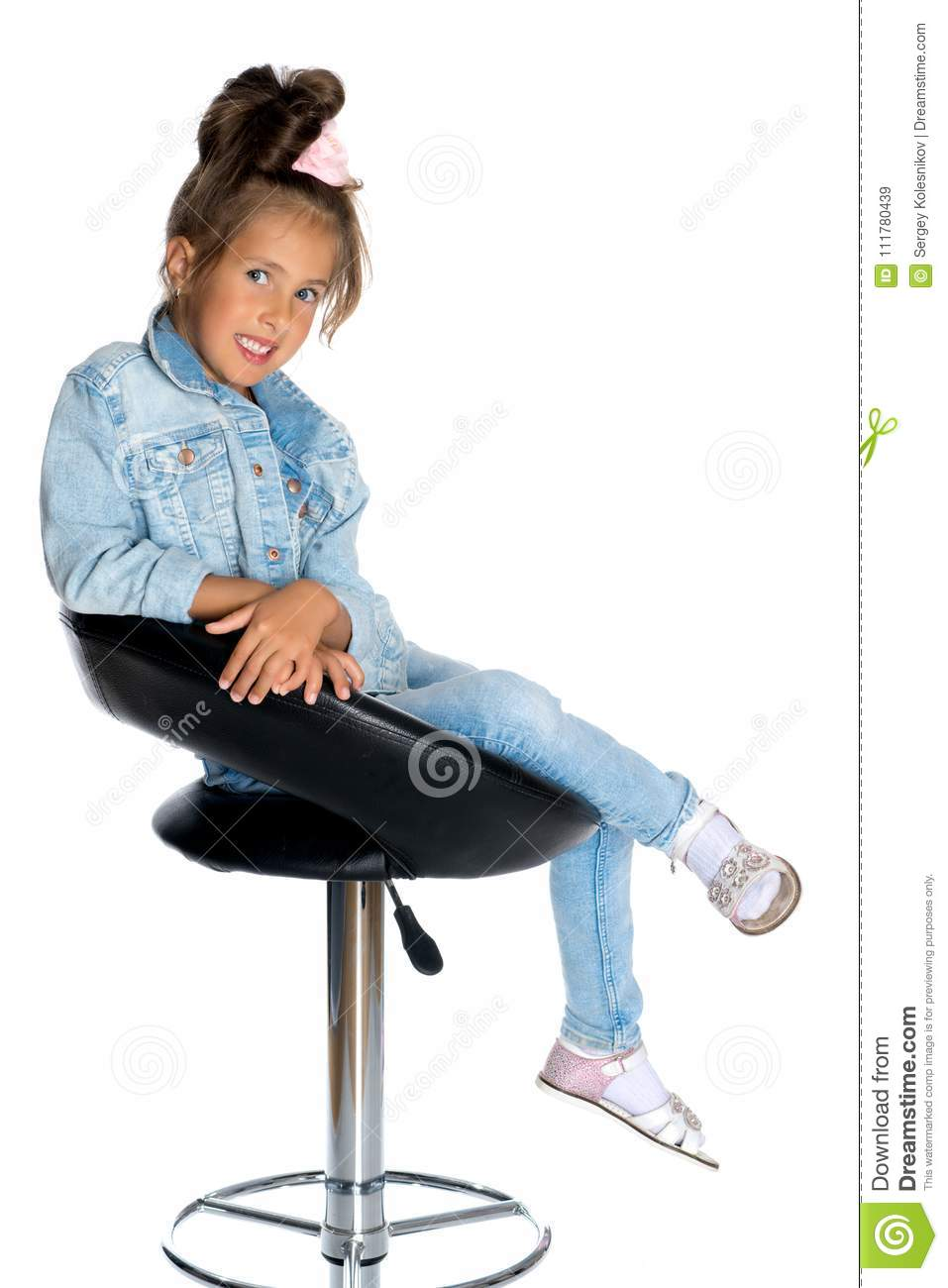 Little girl on a swivel chair