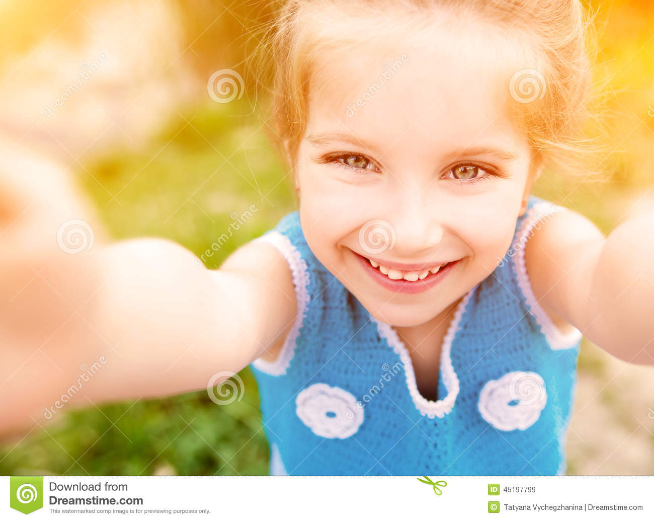 Little girl taken pictures of her self