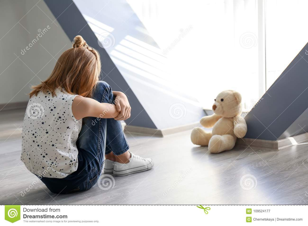 Download Little Girl With Teddy Bear Sitting On Floor Near Window Stock Image - Image of difficulty, month: 109524177