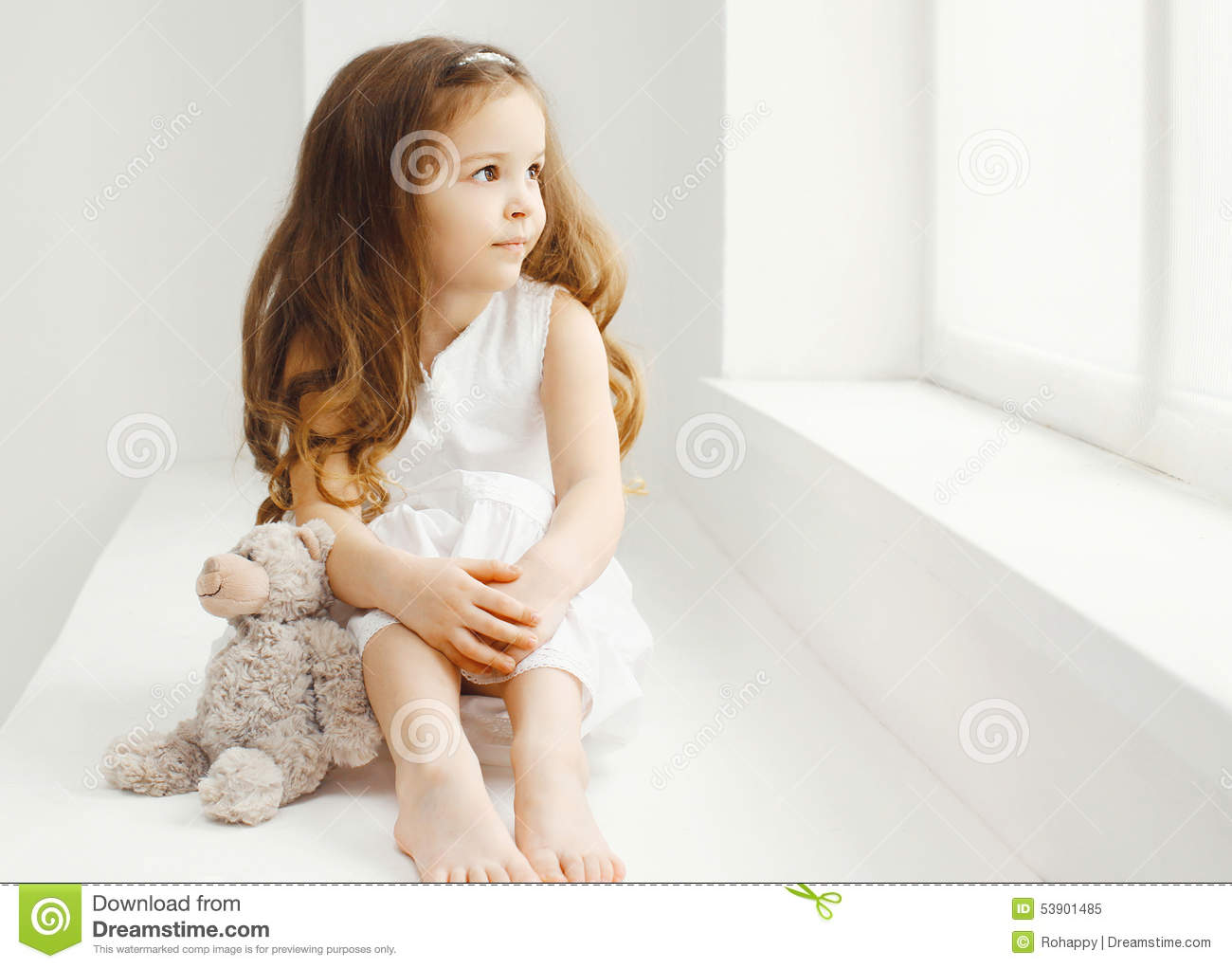 Cute Baby Playing With Teddy Bear Toy At Home In White ...