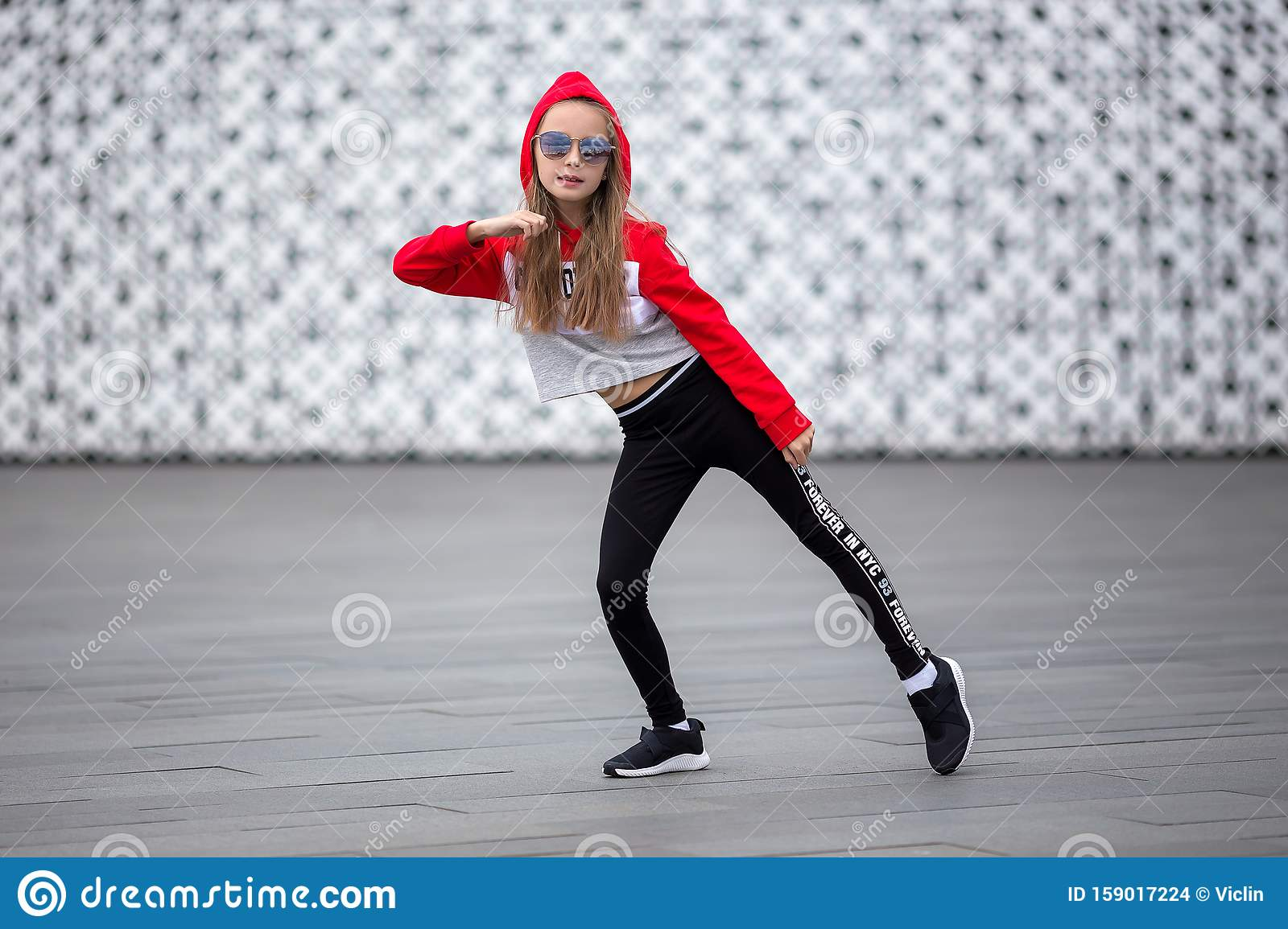 Little Girl In A Tracksuit Is Dancing Modern Dance On The Street Young Urban Hip Hop Dancer Stock Photo Image Of Girl Dancing 159017224
