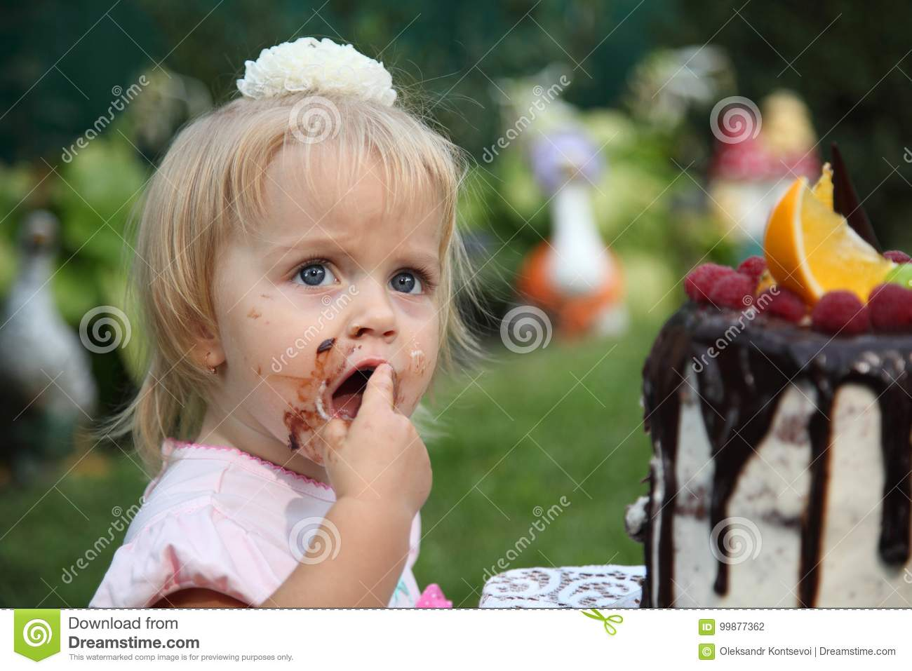 A little girl is trying a birthday cake. Birthday Cake With Candles for  Little Girl d1670eedd