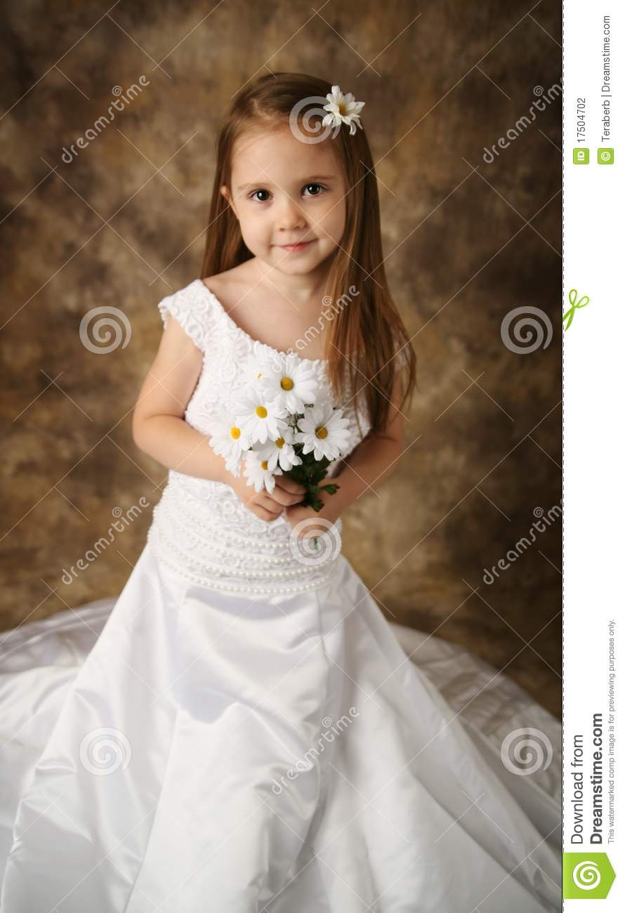 Little Girl Trying On Mommy 39 S Wedding Dress Stock Photo