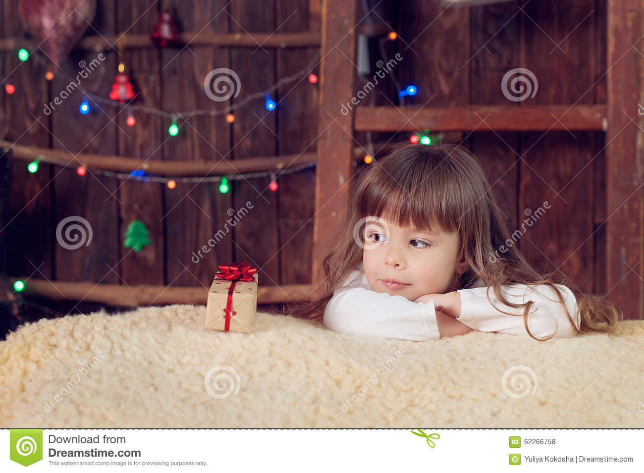 Little Girl Under The Tree On Christmas Stock Photo
