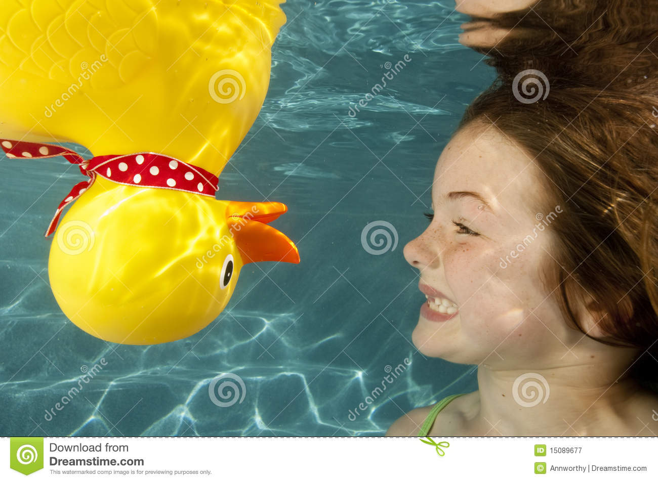 Little Girl Underwater Swimming With Rubber Duck Royalty ...