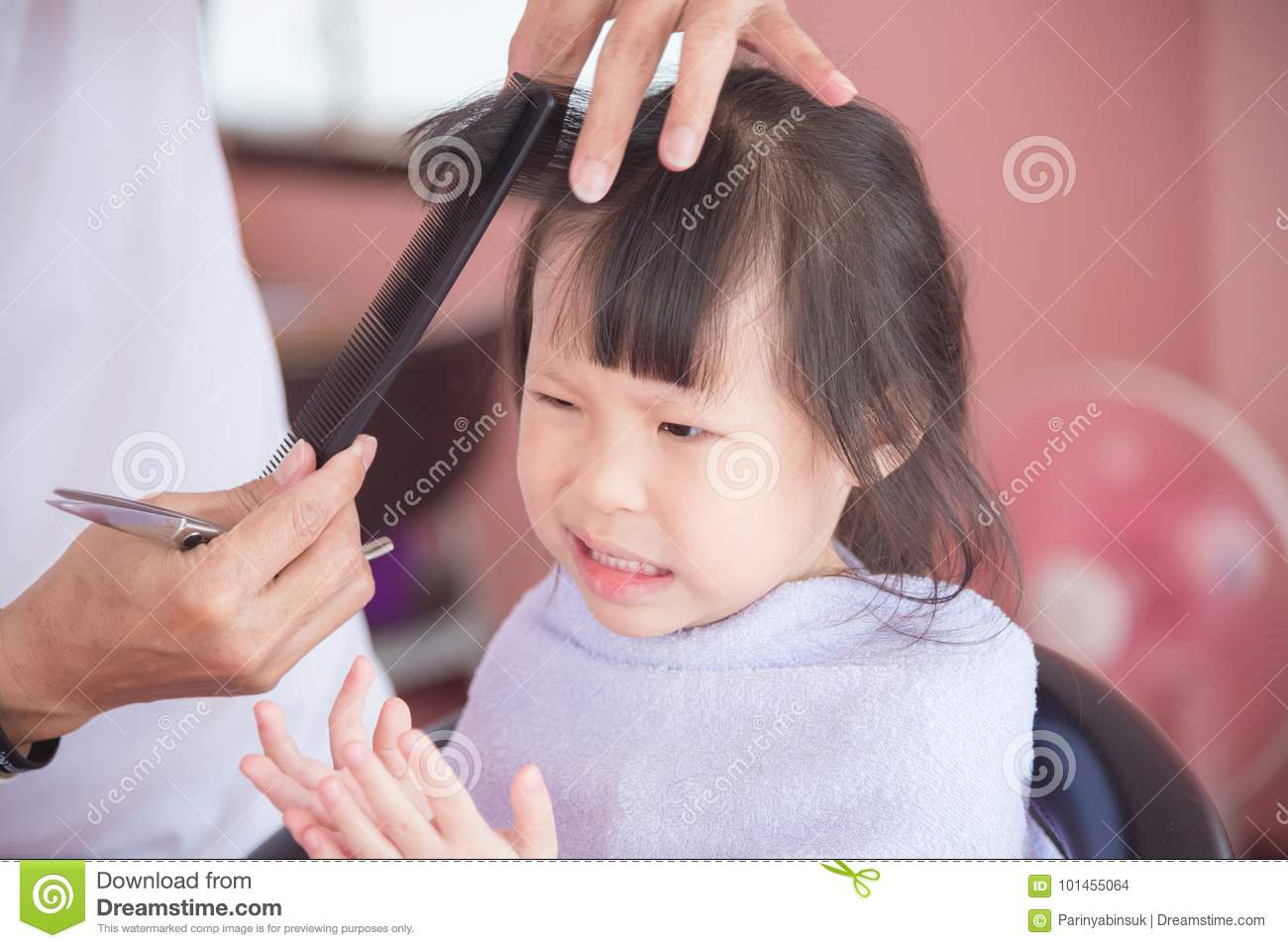 Little Girl Unhappy With First Haircut By Hairdresser Stock Photo