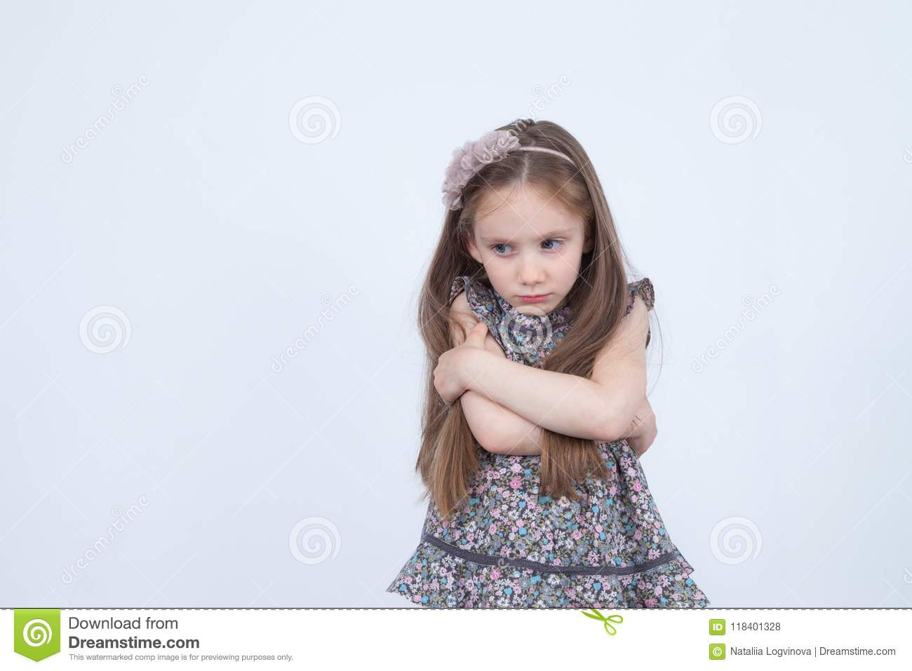 Little girl with upset emotion. Unhappy and upset child. Toddler in bad mood. Emotional girl. Angry emotions.