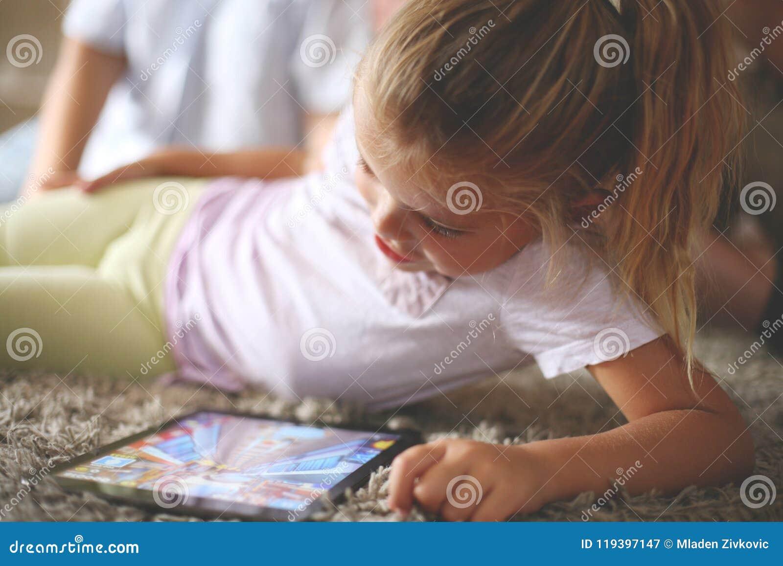 Little girl using digital tablet.