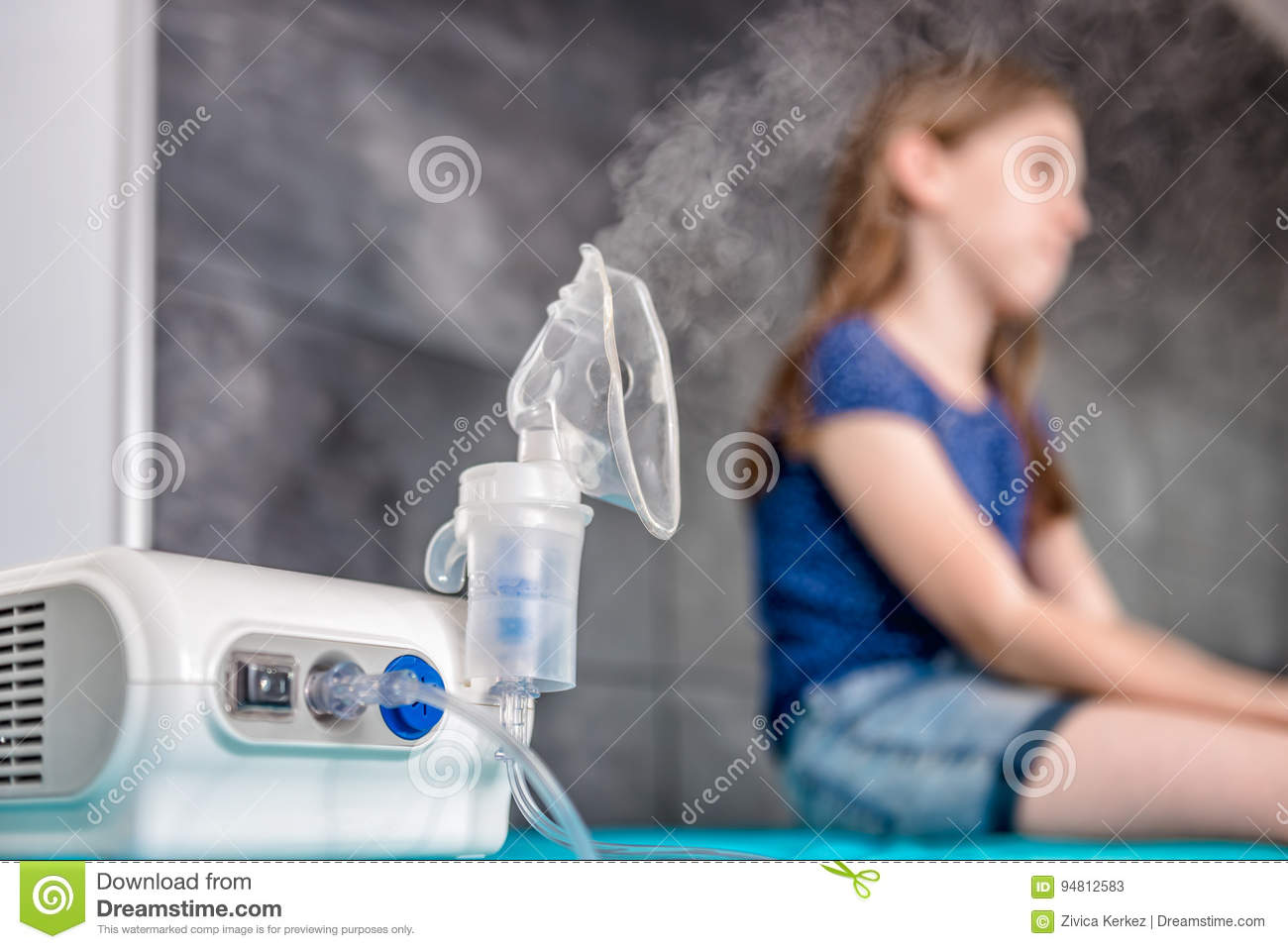 Little girl waiting for medical inhalation treatment with a nebulizer