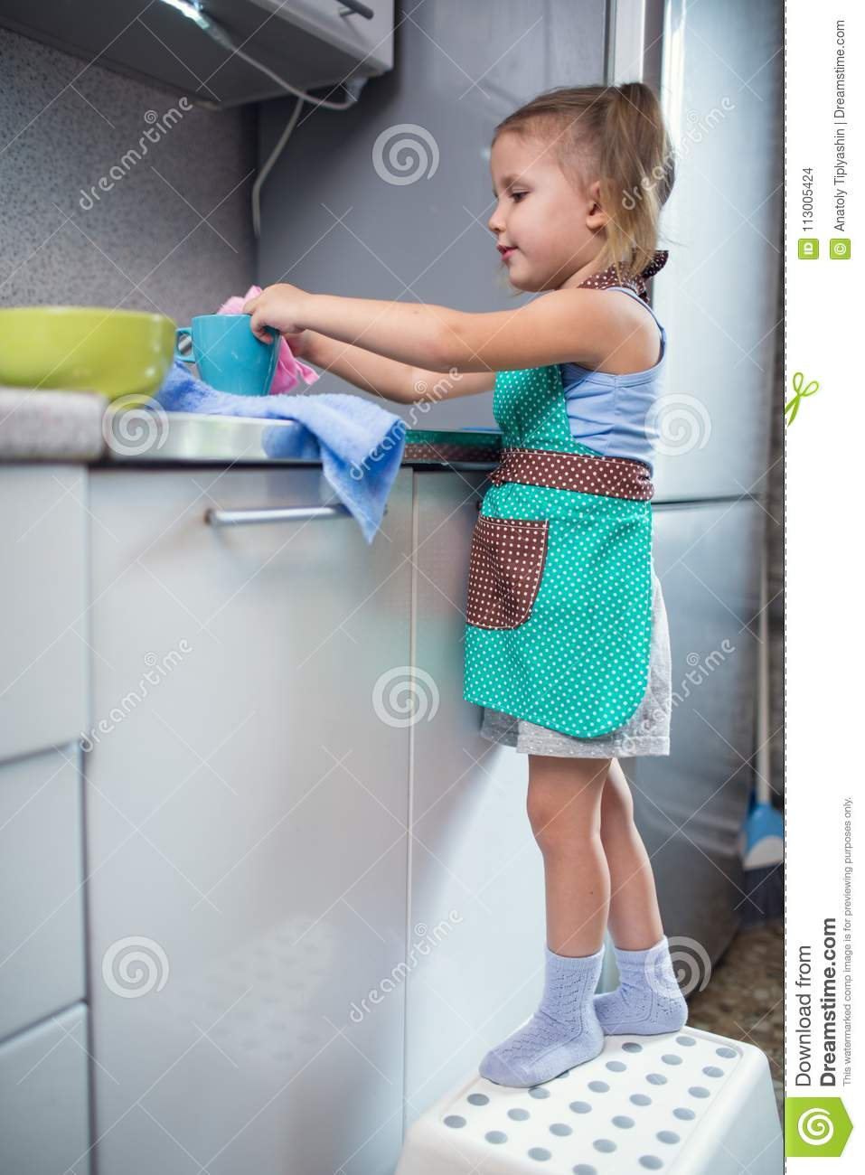 Little Girl Washes Dishes At Home In The Kitchen Stock Photo - Image ...