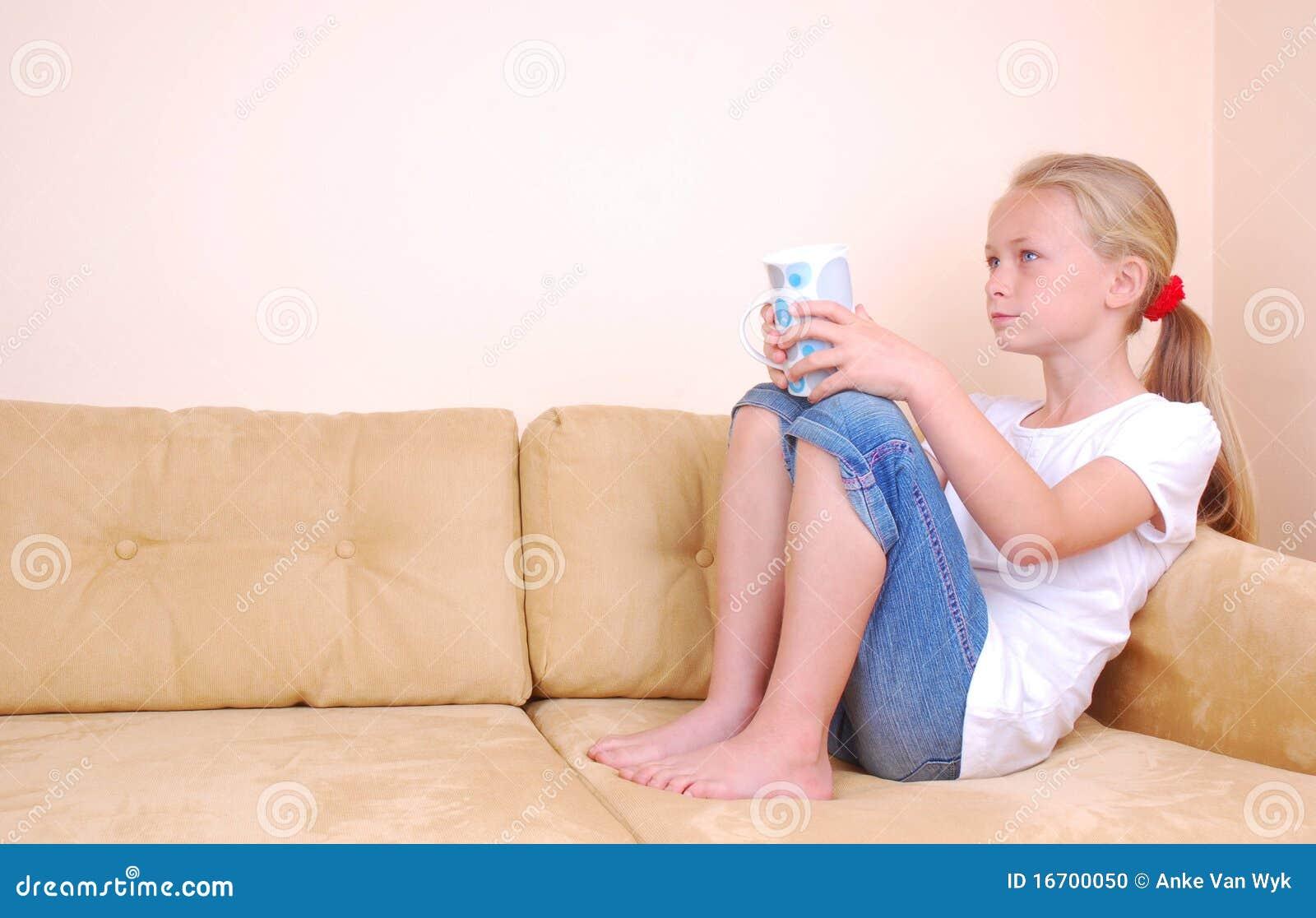 little girl watching tv stock photo image 16700050