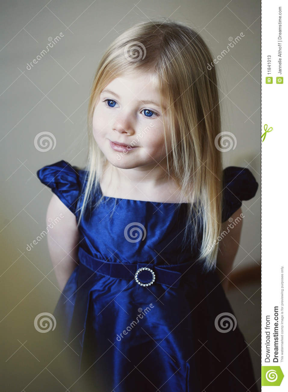 Little girl wearing blue holiday christmas dress matching her blue