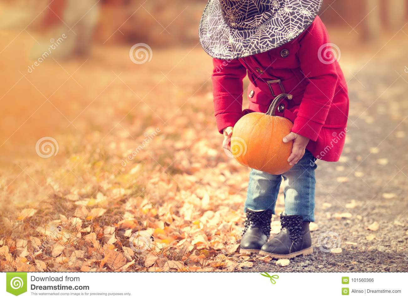 23f39ae57 Little Girl Wearing Halloween Witch Hat And Warm Red Coat