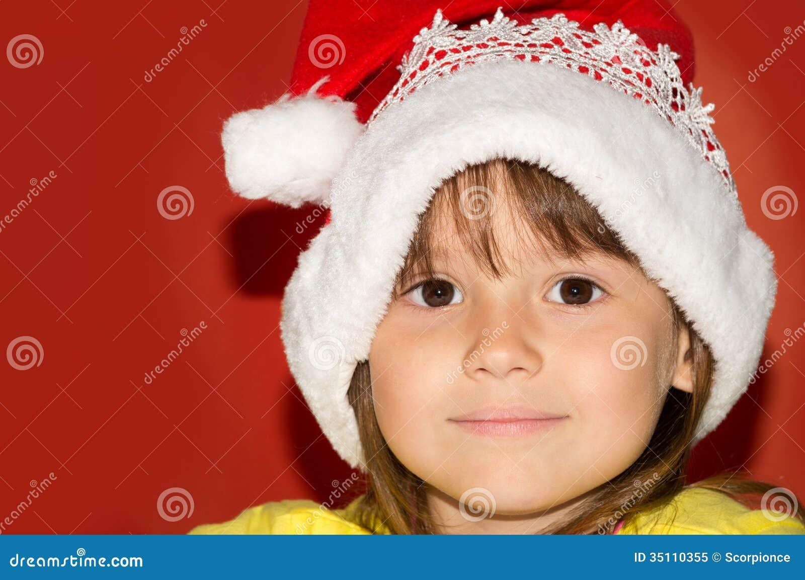 Little girl wearing santa hat
