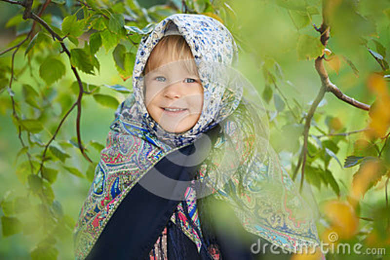 Little girl wearing traditional russian pavloposadsky headscarf