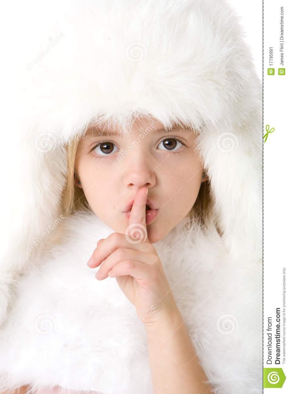 Little Girl Wearing A White Fur Coat And Hat Stock Image