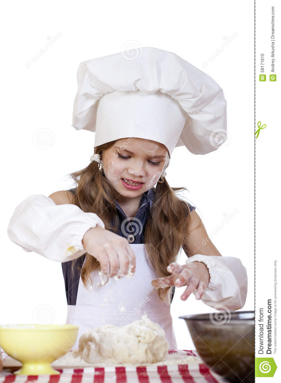 White apron and hat - Little Girl In A White Apron And Chefs Hat Knead The Dough