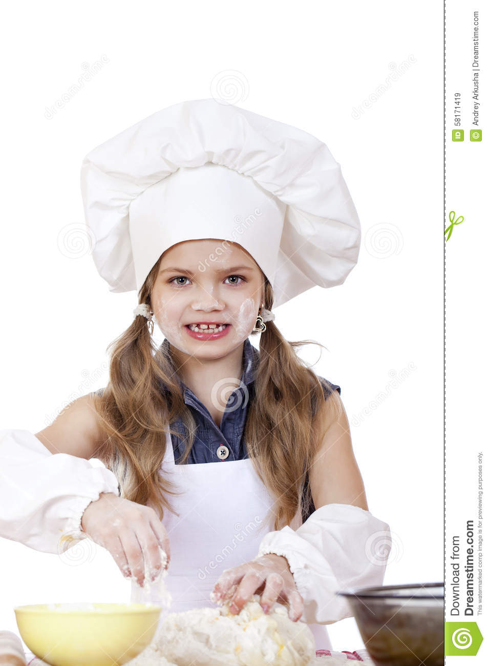 White apron girl - Little Girl In A White Apron And Chefs Hat Knead The Dough In Th