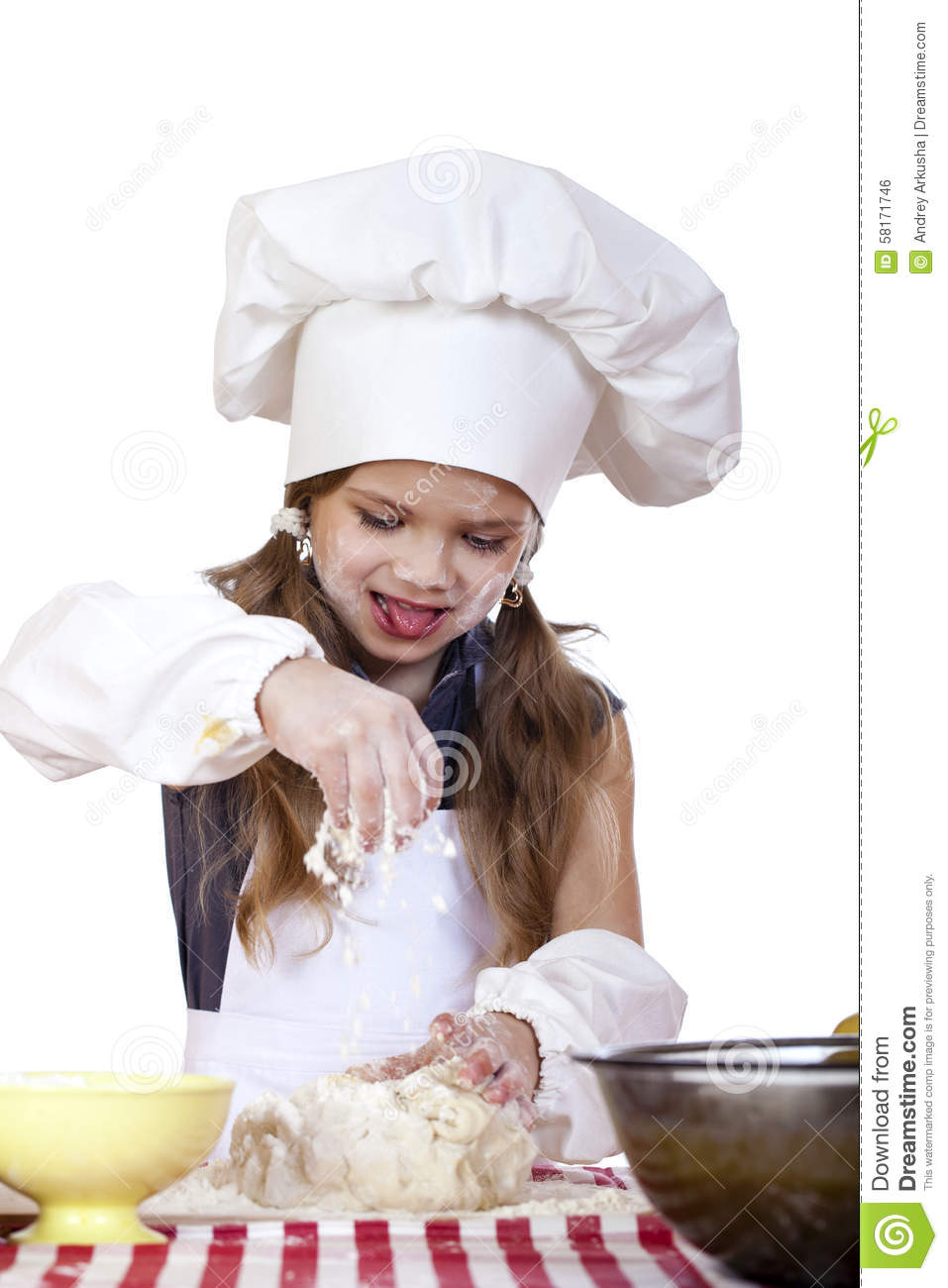 White apron and hat - Little Girl In A White Apron And Chefs Hat Knead The Dough In Th
