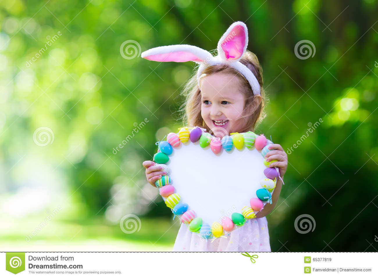Little Girl With White Board For Easter Greetings Stock Image