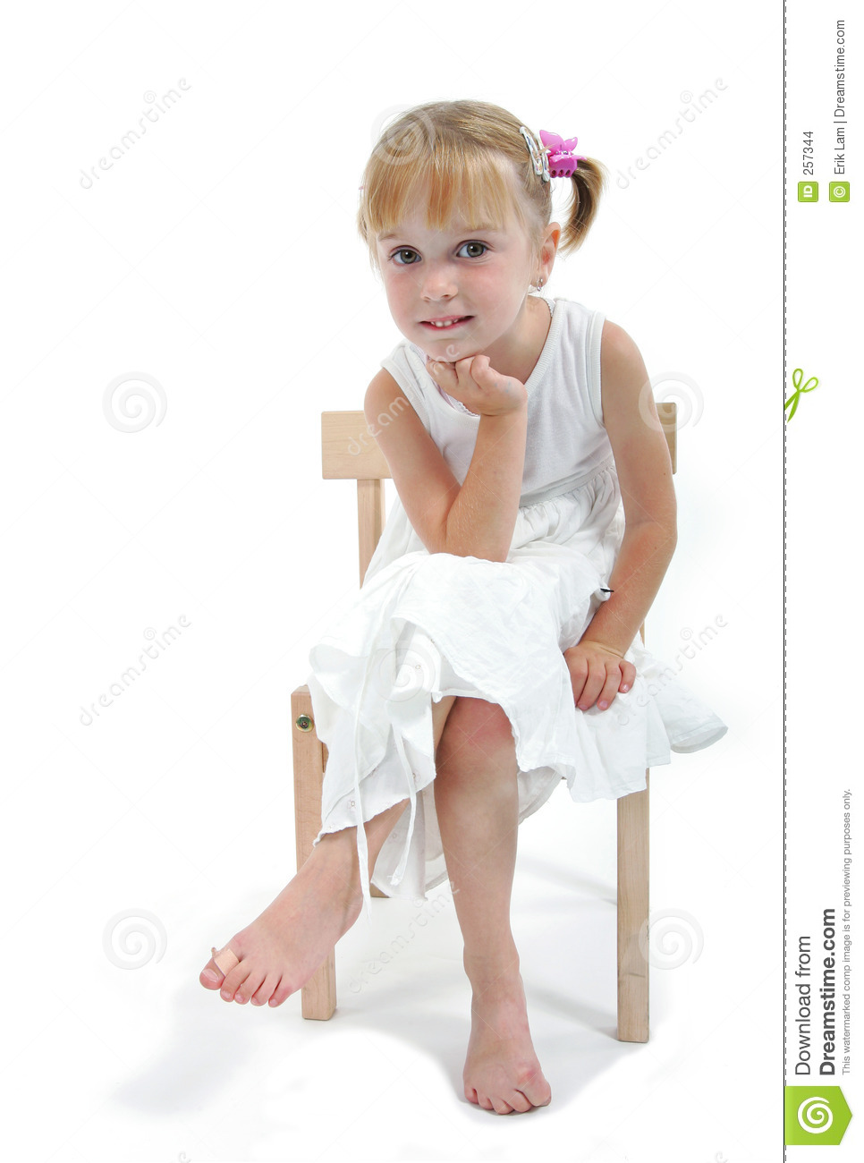 Little Girl In White Dress Sitting On Chair Stock Images