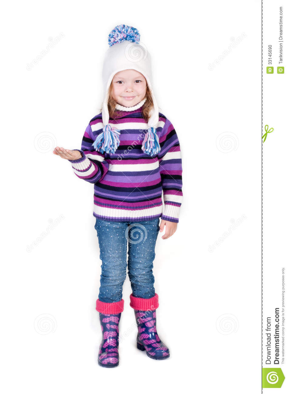 little girl in winter clothes with empty hand stock photo