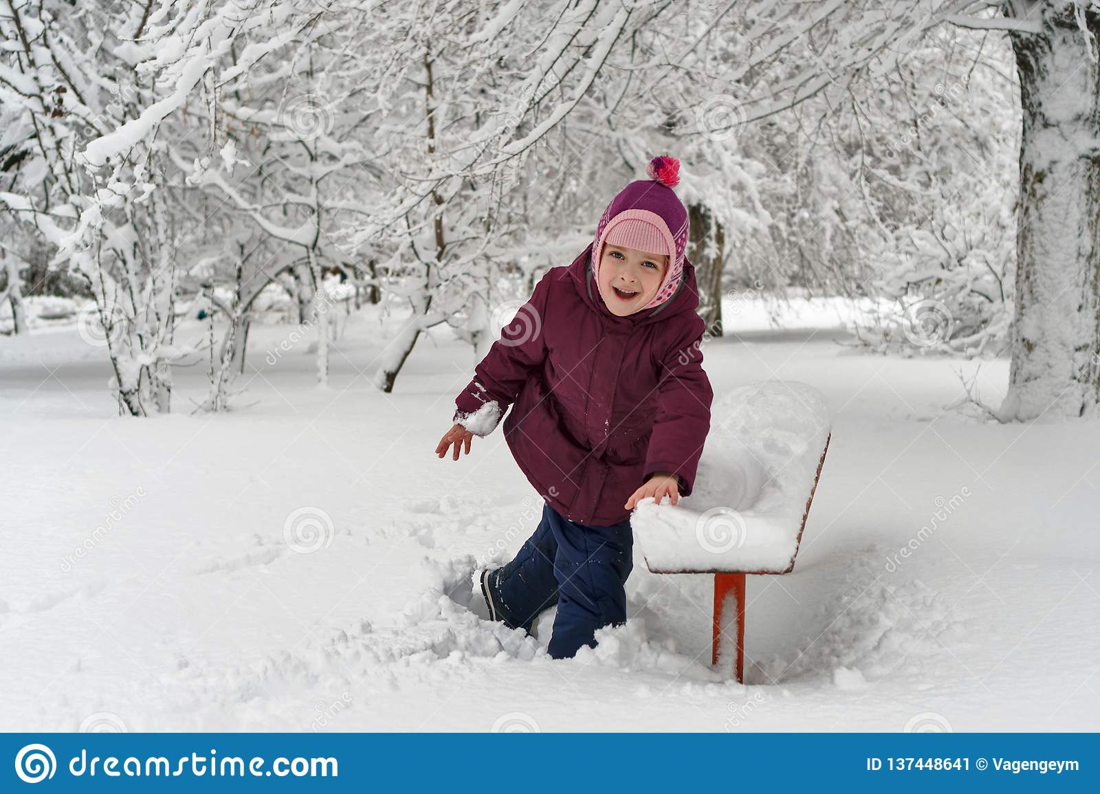 Little girl in winter outdoors