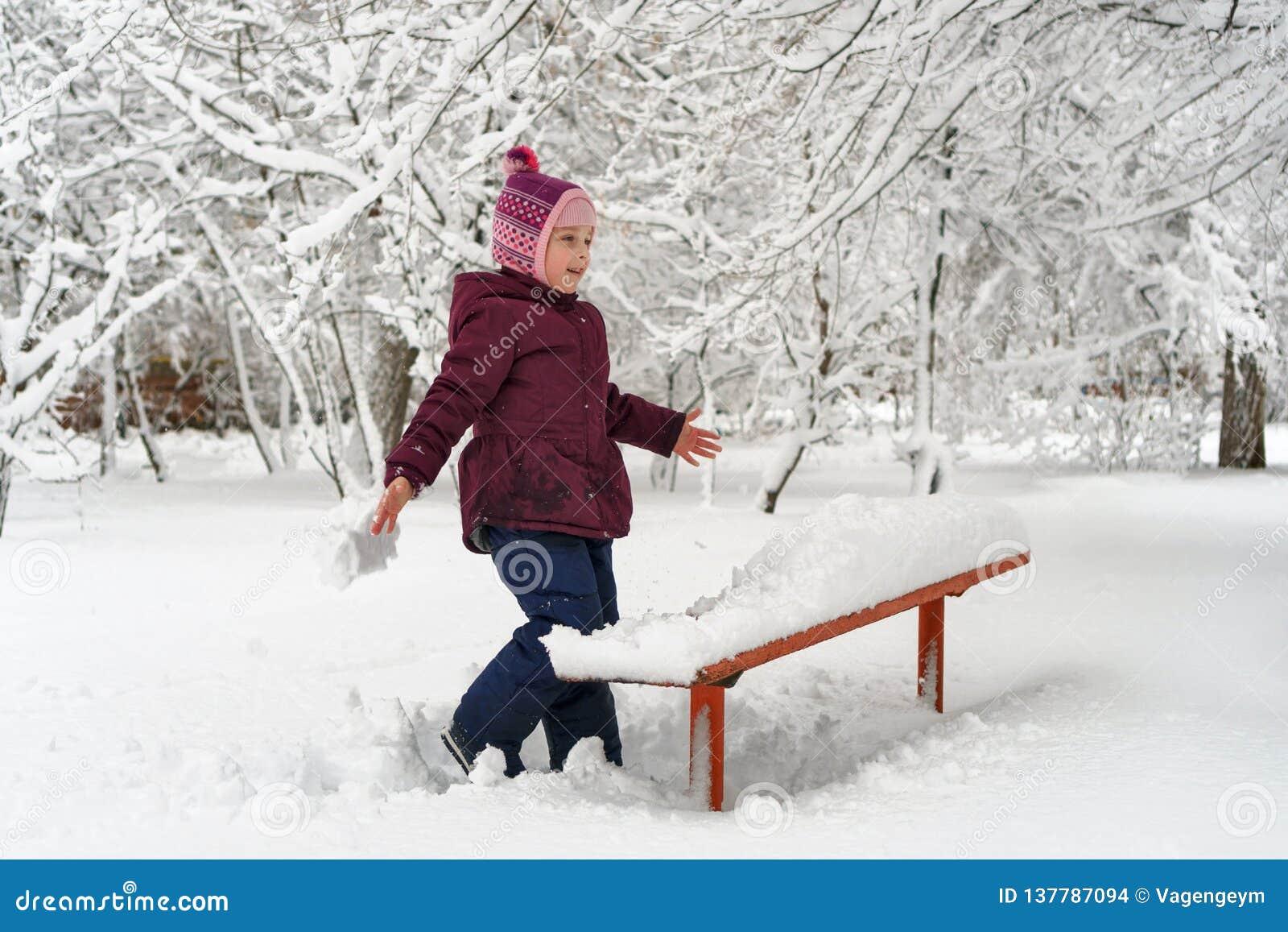Little girl in winter outdoors