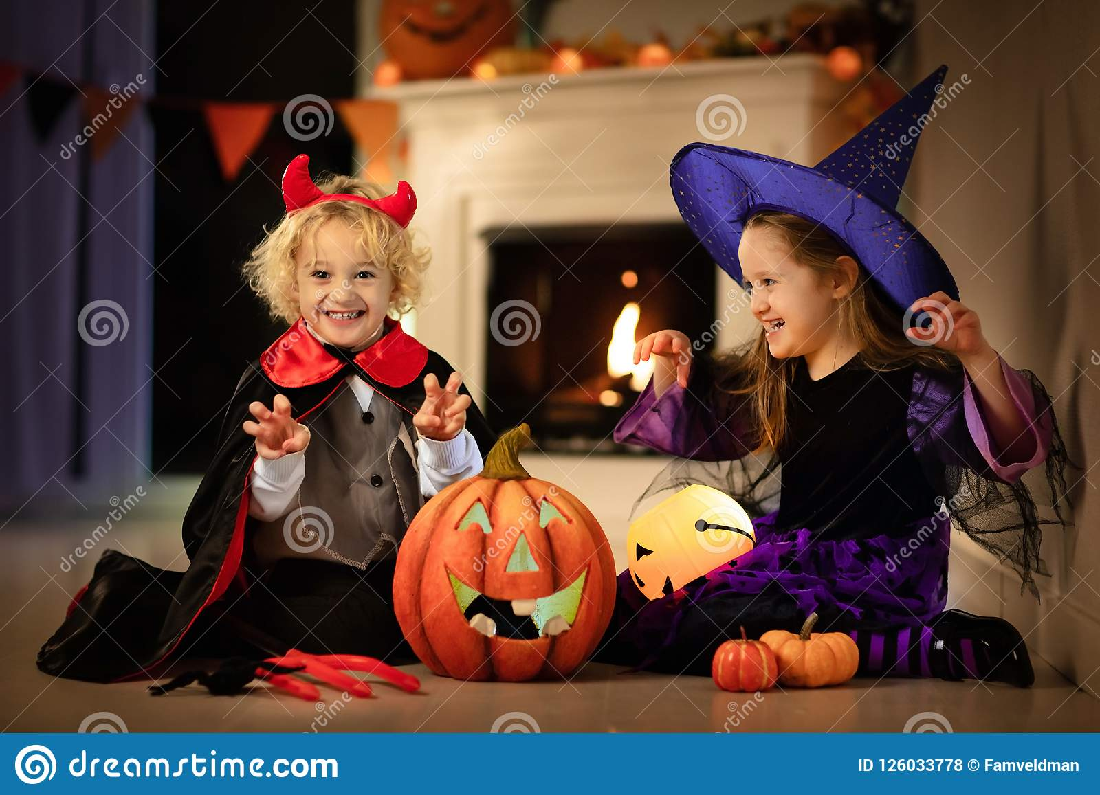 Kids in witch costume on Halloween trick or treat
