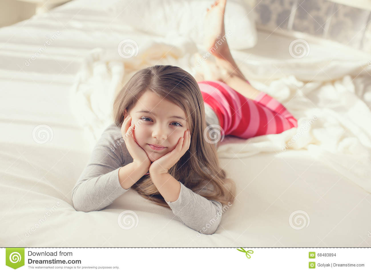 The Little Girl Woke Up And Lay In Bed Stock Photo Image Of Chin