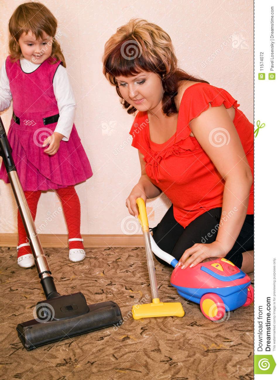 Little Girl And Woman Vacuum A Carpet Stock Photography - Image: 11574072