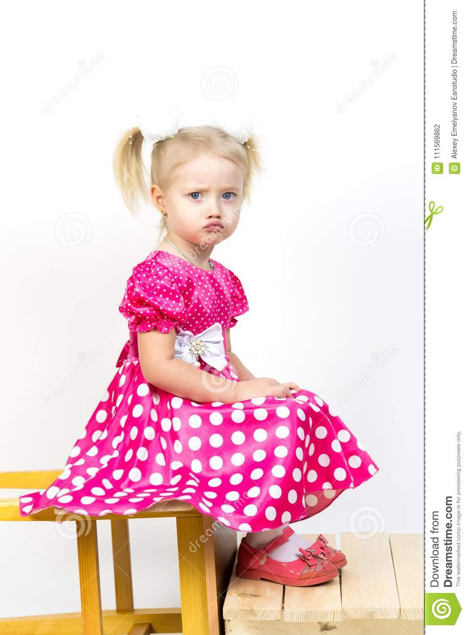 c1853474a2 Little Girl 3 Years Old In A Red Dress With Bows In Her Hair. Stock ...