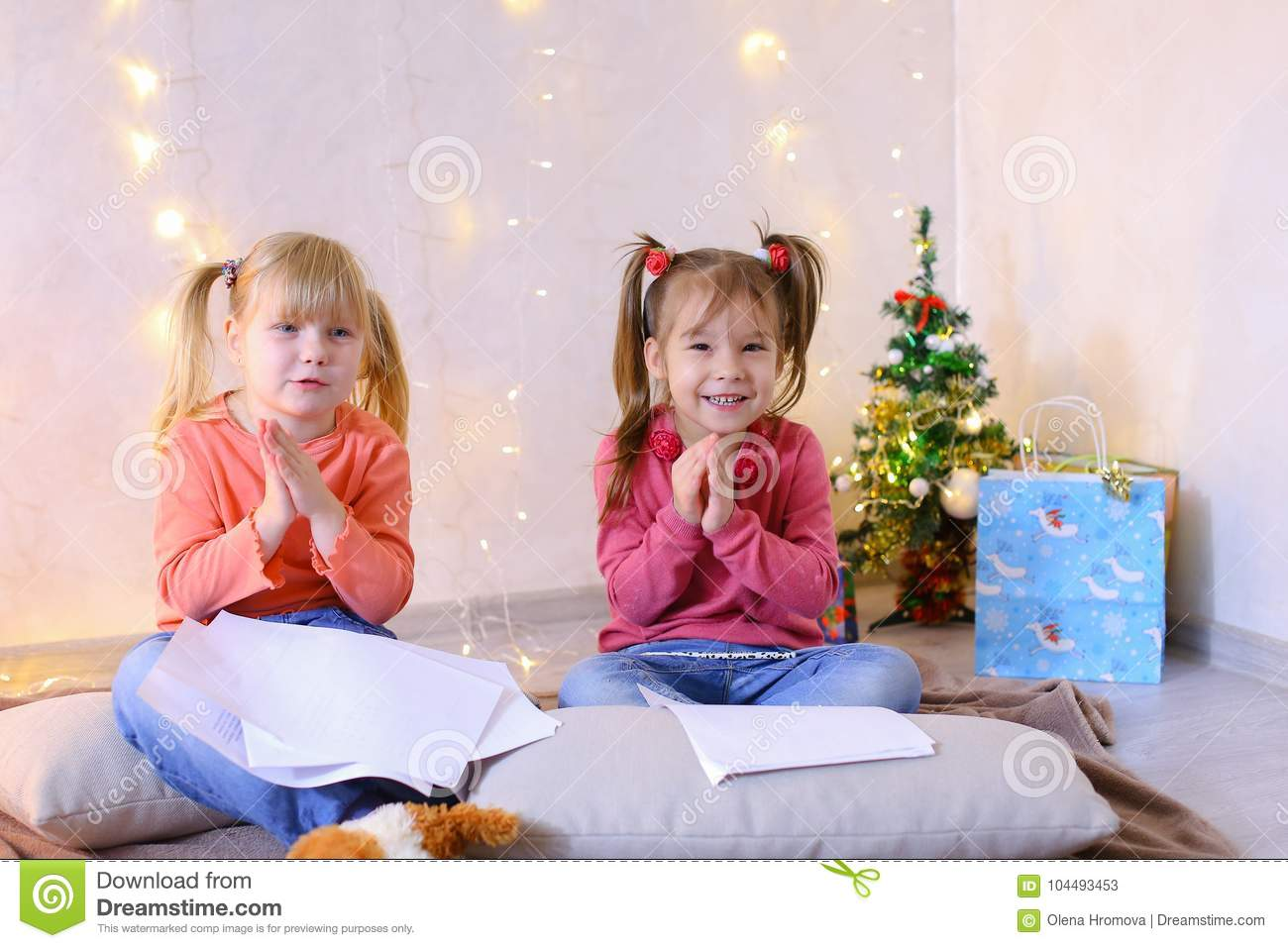 little girls in anticipation of new years holidays make wishes