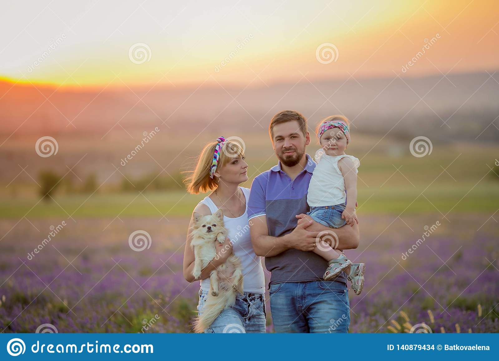 Little girls with dog and falily playing in lavender field
