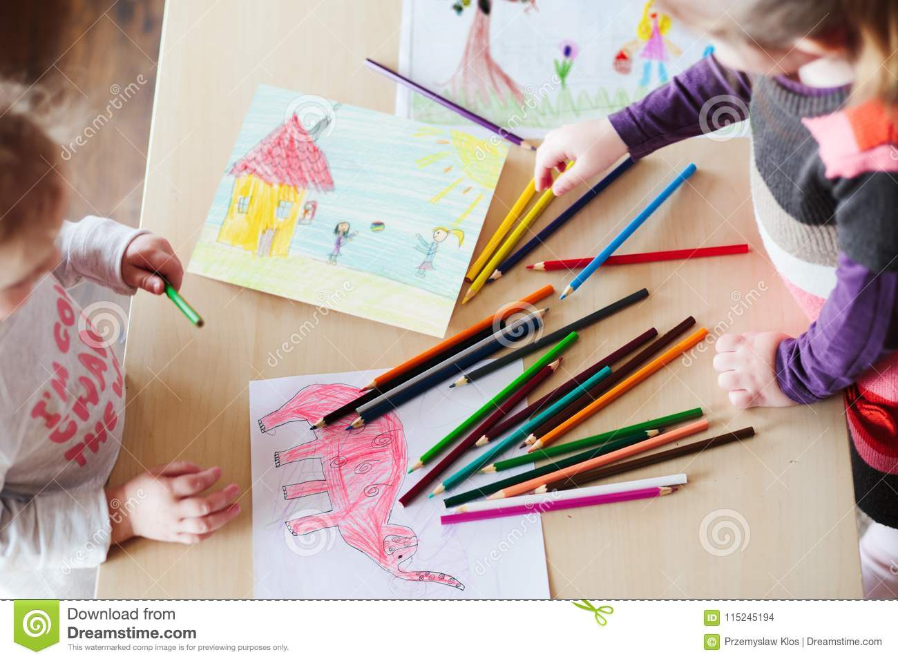 Little girls drawing a colorful pictures of elephant and playing