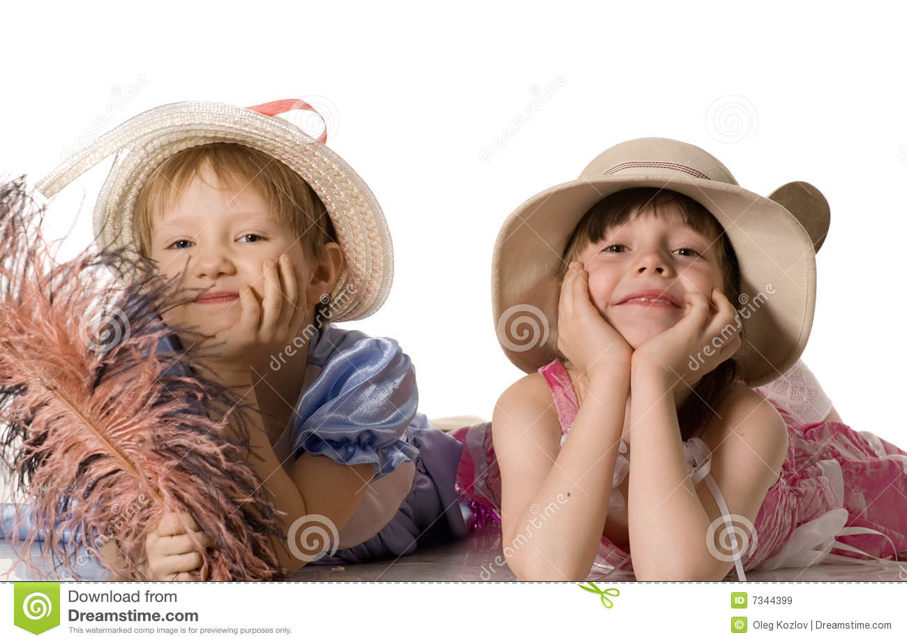 Little girls in hats lie on the floor and smile