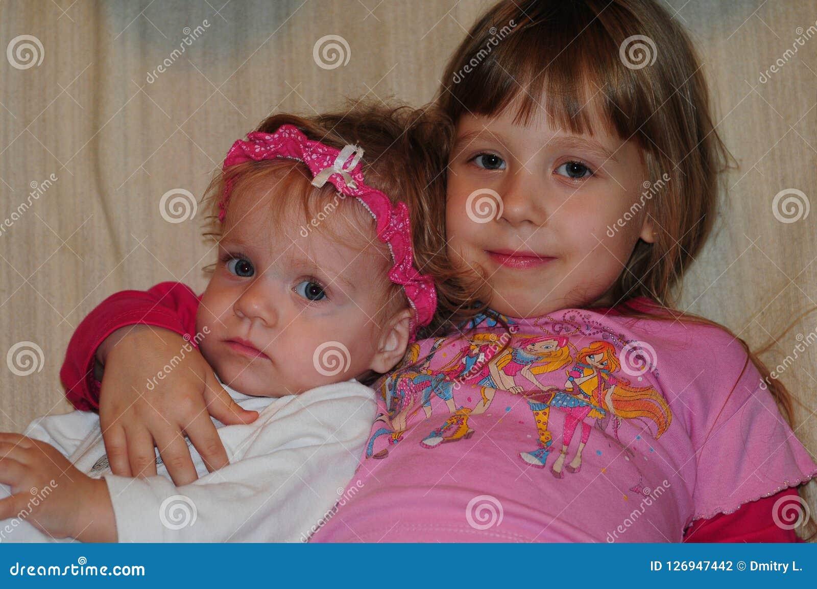 Little girls posing for photographer