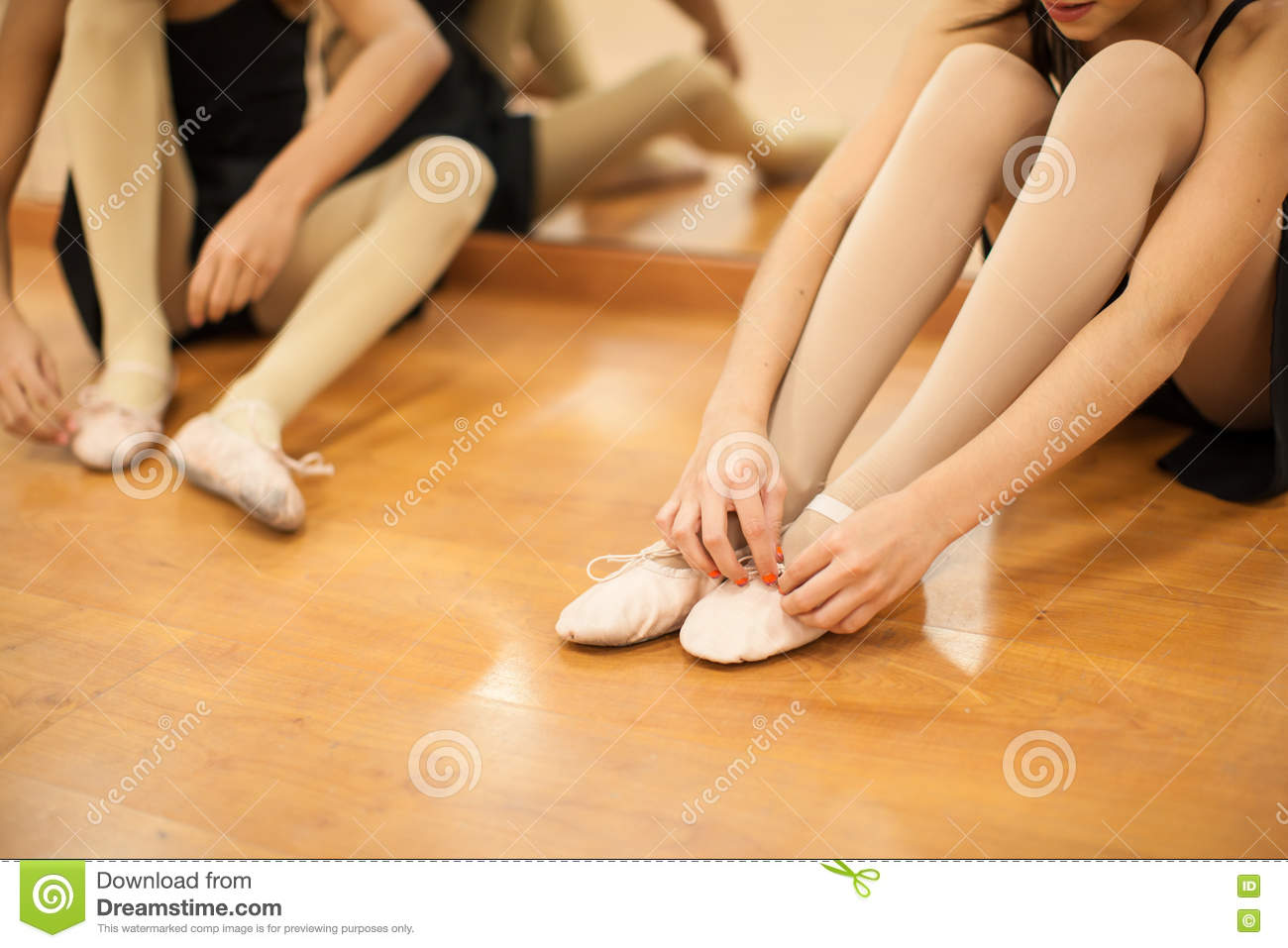 Little Girls Putting Their Dance Shoes