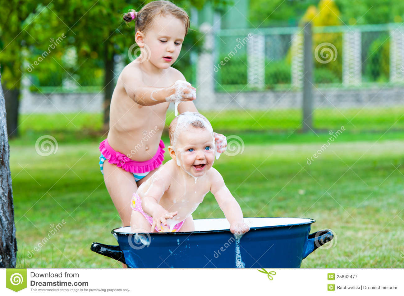 Little Girls Take A Bath In Vintage Tube Stock Image
