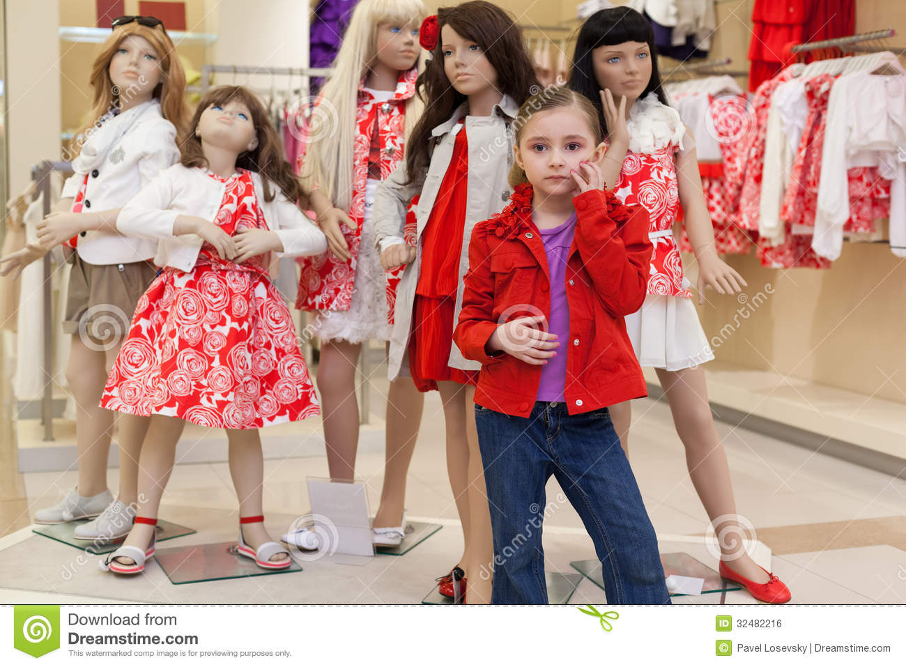 Royalty Free Stock Image: Little girls trying on clothes together with
