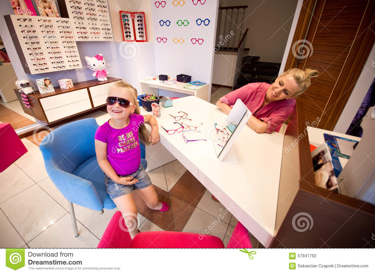Little Girl And Optician In A Shop Editorial Photography Image Of