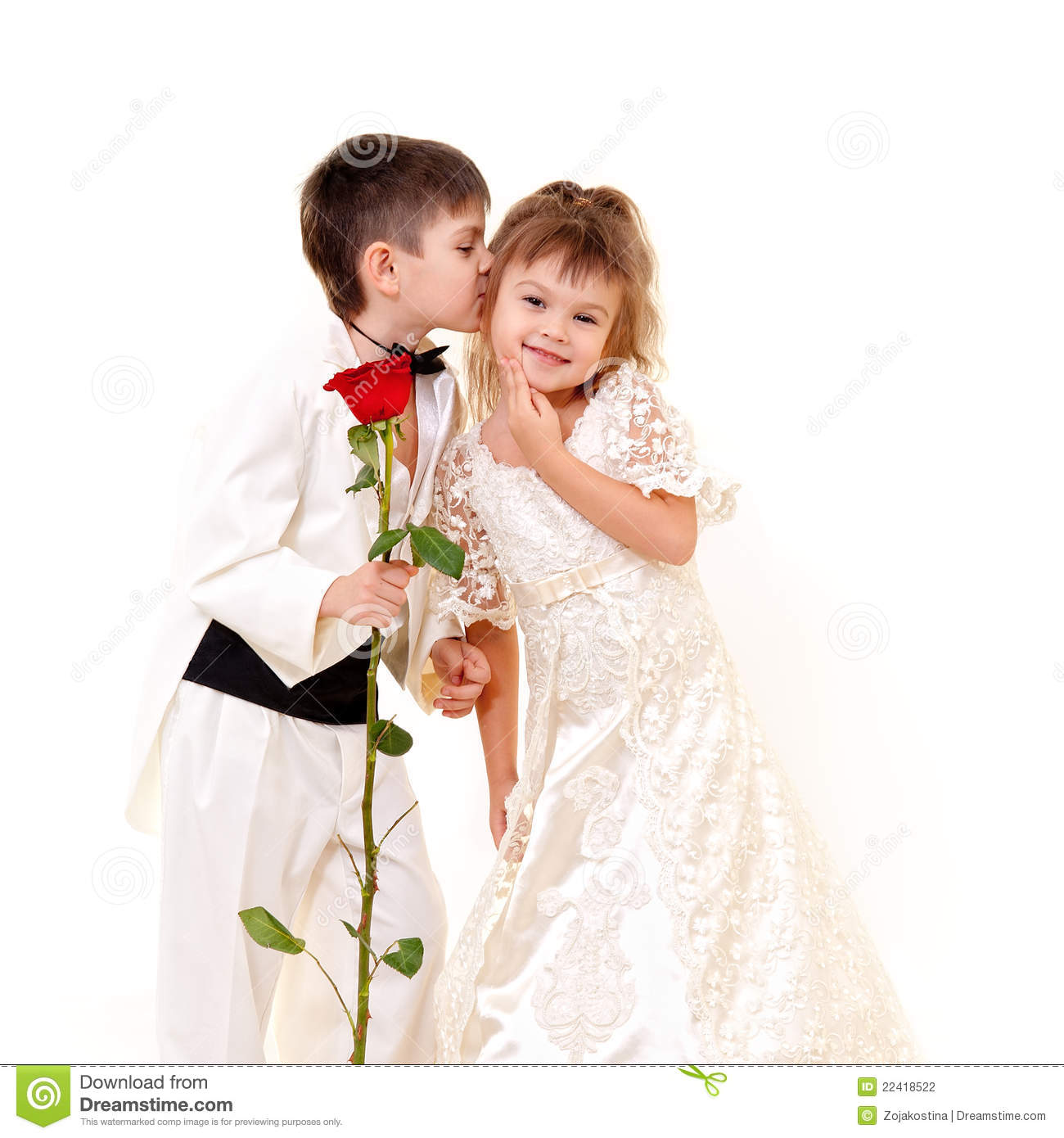 Little Groom Kissing Little Bride Stock Photography