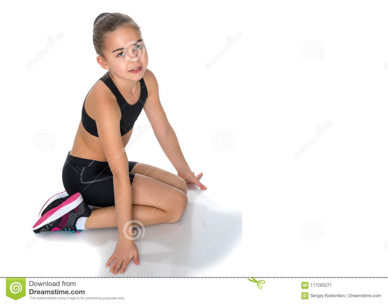 95fafdffc The Little Gymnast Perform An Acrobatic Element On The Floor. Stock ...