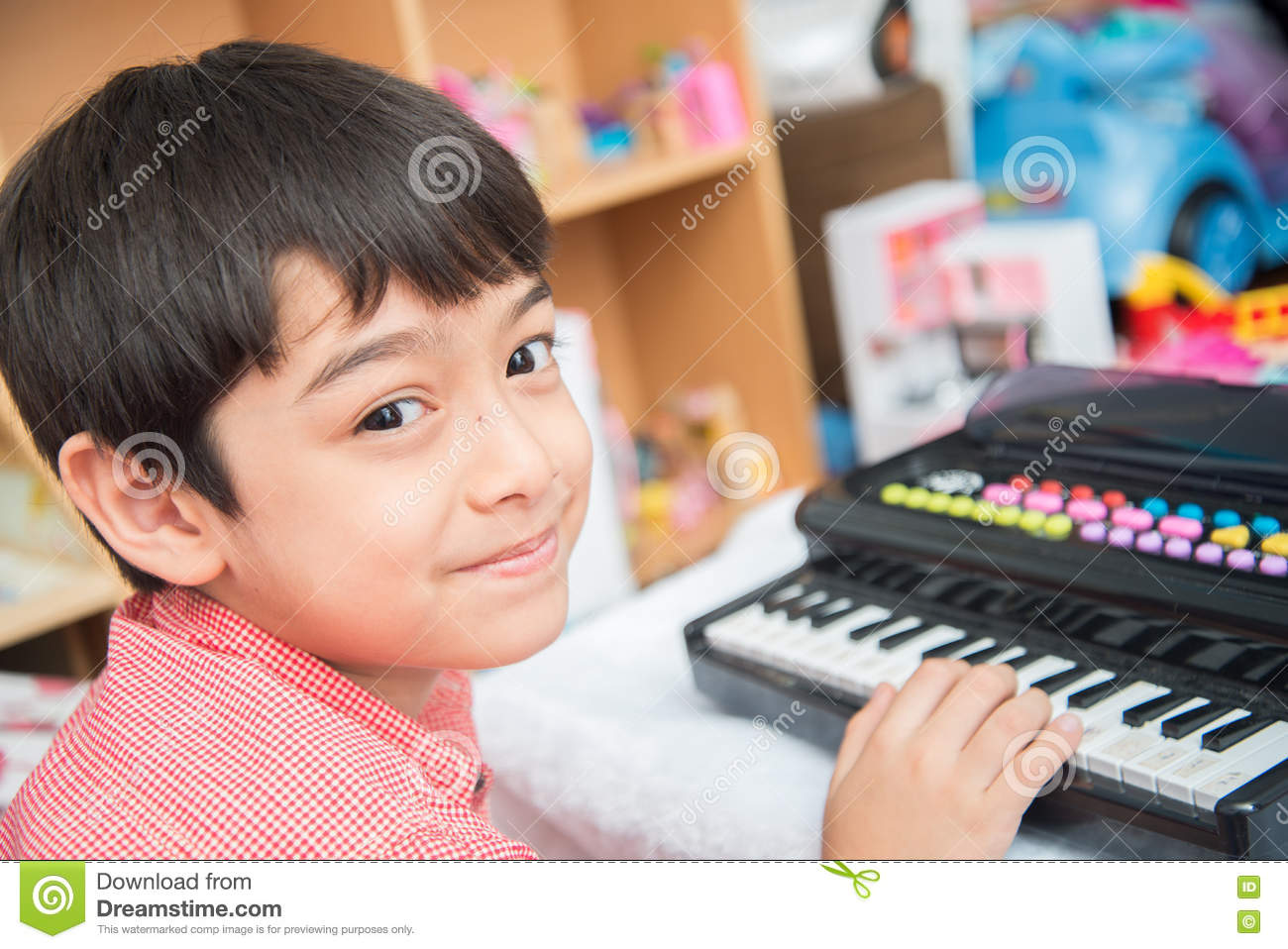 Little hand boy playing small keyboard practice indoor