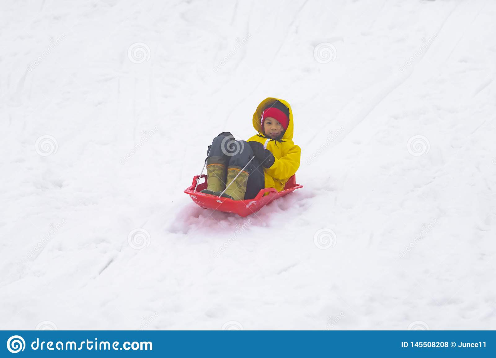 Japanese girl is sliding down the snow sled in Gala Yuzawa Ski resort