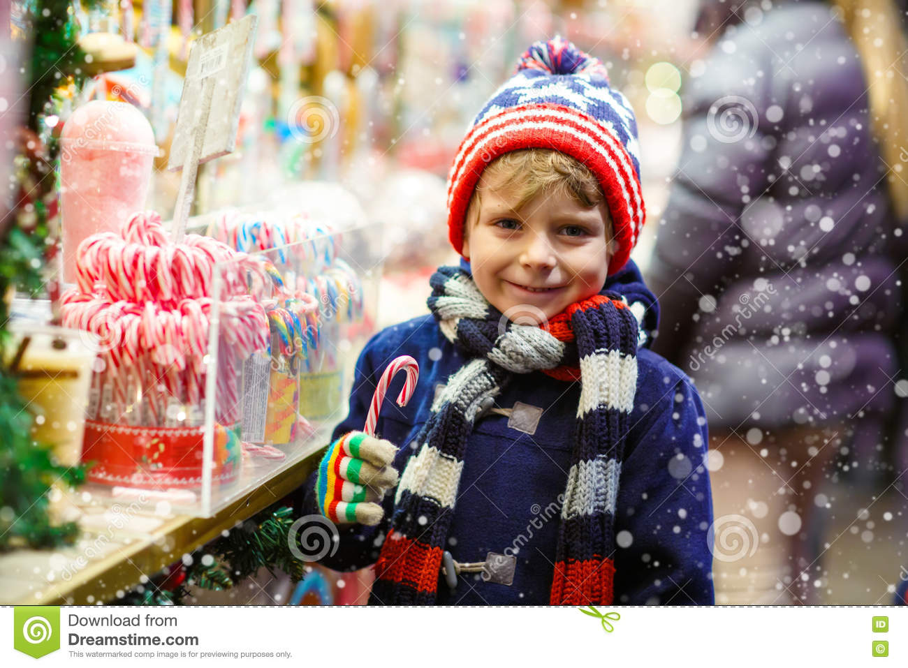 Little Kid Boy With Candy Cane Stand On Christmas Market Stock Photo ...